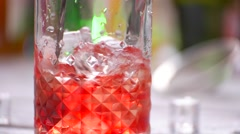 Spoon mixing cocktail in jug. Stock Footage
