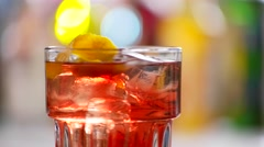 Glass of negroni quickly rotates. Stock Footage