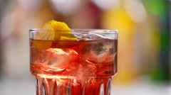 Glass of negroni turning around. Stock Footage