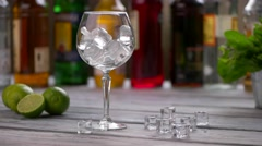 Ice cubes falling into glass. Stock Footage
