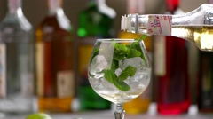 Bottle pours drink into glass. Stock Footage
