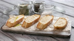 Liquid pours on bread slices. Stock Footage