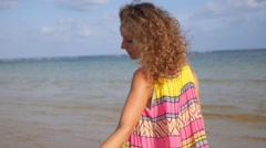 Woman in Colorful Summer Dress Walking on Beach. Slow Motion. Stock Footage