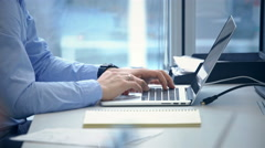 Man's hands typing on laptop keyboard Stock Footage