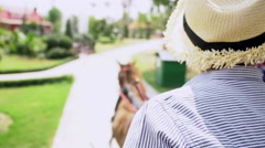 4k , Asian boy sit on carriage, moving on road Stock Footage