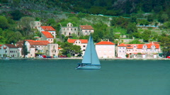 Boat sailing in a sea at Bay of Kotor in Montenegro Stock Footage