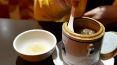 Close up womna pouring seafood soup into bowl inside Chinese restaurant Stock Footage