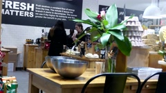 One side of shopper inside Lush homemade cosmetics store Stock Footage