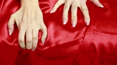 female hands in red leather handcuffs. sex toys. - stock footage