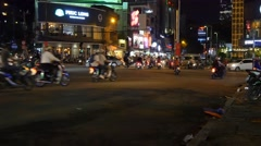 Busy city centre traffic intersection night lights crowd cars people chaos 4k Stock Footage