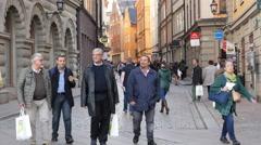 People Walking in Alleyway  - Stockholm Sweden - stock footage