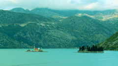 Island of Our Lady of the Rocks and island St. Djordja in Perast, Montenegro Stock Footage