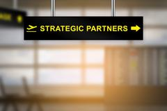 Strategic partners on airport sign board Stock Illustration
