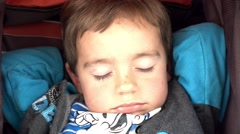Face of child asleep hands on the nape Stock Footage