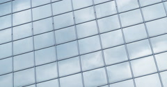 Time lapse clouds passing shiny office windows loop 4K - stock footage