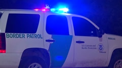 Border Patrol vehicle at night with flashing lights. Stock Footage