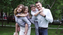 Happy family having fun outdoors in the park. Slow motion Stock Footage