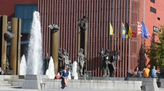Concert hall and sculpture group with fountain at Het Zand in Bruges, Belgium Stock Footage