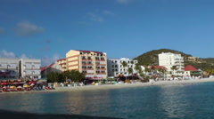SINT MAARTEN -  Beach and promenade in Sint Marteen, shot from boat Stock Footage