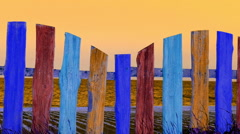Multi-colored fence against the sea. Stock Footage