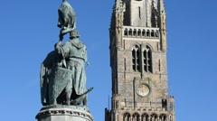Statue of Jan Breydel and Pieter De Coninck and belfry in Bruges, Belgium - stock footage