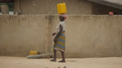 Africa Ghana Aframso woman carry water 4K Stock Footage