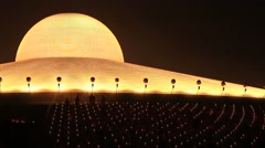 Night view Wat Phra Dhammakaya during Buddhist ceremony, Bangkok, Thailand Stock Footage