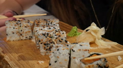 Nice close up footage of sushi eating. Girl's hands picking sushi Stock Footage