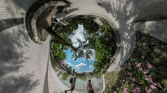 360 Degree Rabbit Hole Planet Family Park Embankment People at Small Lake Among Stock Footage