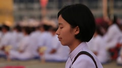 Thai girl in Buddhist ceremony. Wat Phra Dhammakaya, Bangkok. Thailand Stock Footage