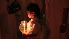 Thai child during Buddhist ceremony. Wat Phra Dhammakaya, Bangkok, Thailand Stock Footage
