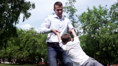 Young boy spinning around in parent's hands Stock Footage