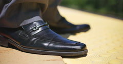 Young Business Man Waiting at Train Station Close Up on Shoes, 4K Stock Footage