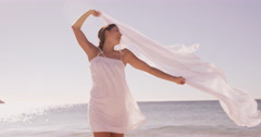 Woman smiling with a sheet Stock Footage