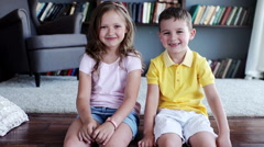 Two child smiling inside the house. indoors Stock Footage