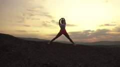 Silhouette of sexy muscular woman with perfect body stretching outdoor on sunset - stock footage