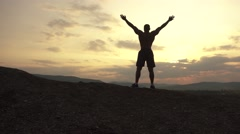 Silhouette of muscular bodybuilder with perfect body posing at the sunrise or Stock Footage