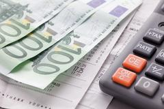 Calculator with Euro notes and receipts Stock Photos