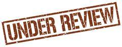 Under review brown grunge square vintage rubber stamp Stock Illustration