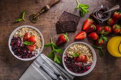 Granola with berries and chocolate - stock photo