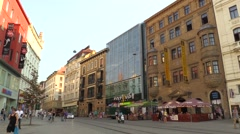 Luxury car passes through the city of Brno, Svobody Square, people in summer Stock Footage