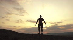 Beauty of human's body. African american bodybuilder posing at sunset during his - stock footage