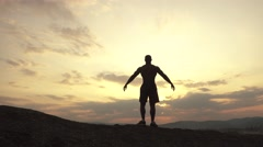 Beauty of human's body. African american bodybuilder posing at sunset or sunrise Stock Footage