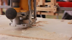3D jigsaw cuts a figure from plywood - stock footage