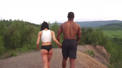 Moment of harmony. Happy mixed race couple athlethic caucasian woman with - stock footage