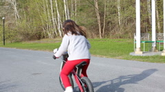 Little girl riding her balance bike in the park Stock Footage