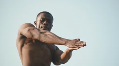 Close-up of strong african american body builder with naked torso showing his - stock footage