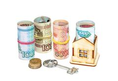 Wooden house, Russian money and key on a white background. Housing costs - stock photo