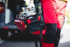 Ambulance man legs plan front of ambulance car Kuvituskuvat