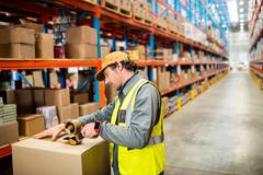 Warehouse worker preparing a shipment in warehouse Stock Photos